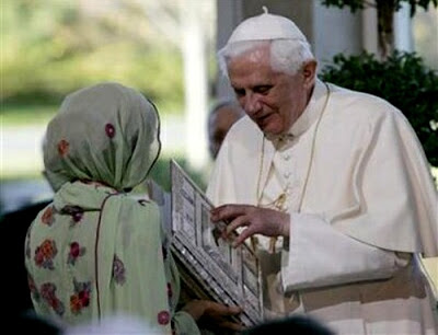 Pope receiving the Quran